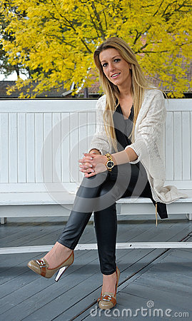 Blond girl sitting on bench