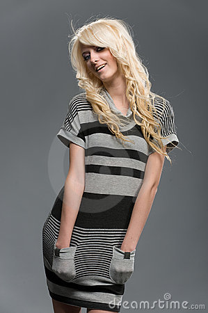 Blond girl in striped clothes studio shot