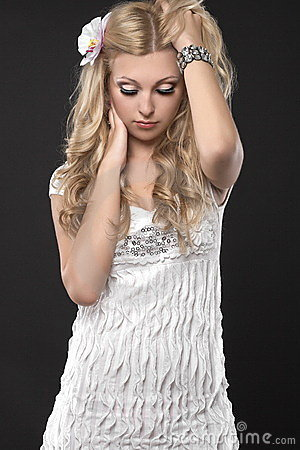 Blond girl in white clothing