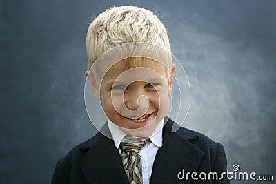 Blond grinning business boy