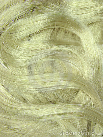 Blond hair curls as texture background