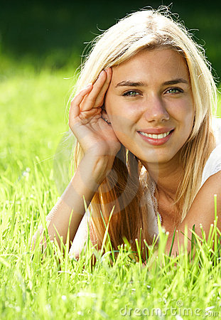 Blond haired teen on field