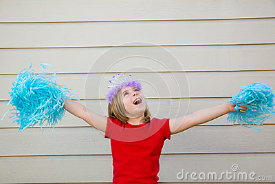 Blond kid girl playing like cheerleading pom poms and crown