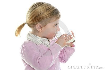 Blond little girl drinking glass of milk