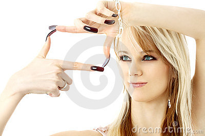 Blond looking through her fingers in a box shape