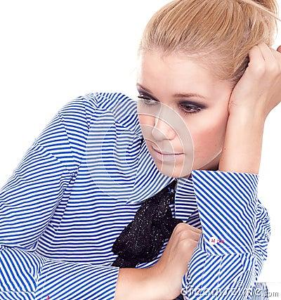 Blond melancholy businesswoman portrait