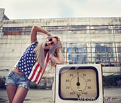 Blond screaming girl on damaged gas station