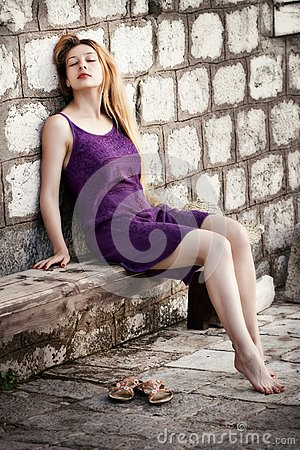 Blond sensual woman and old ancient wall