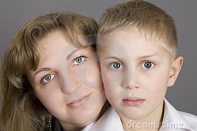 Blond  serious mother with her son