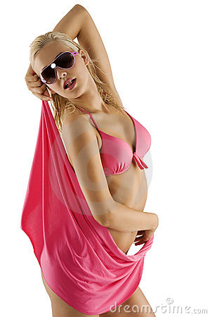 Blond sexy girl in pink bikini and sunglasses