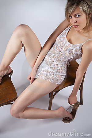 Blond sitting on a chair