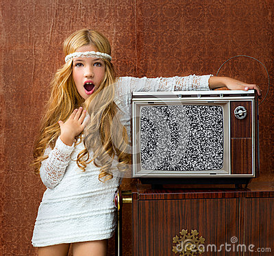 Blond vintage 70s kid girl with retro tv