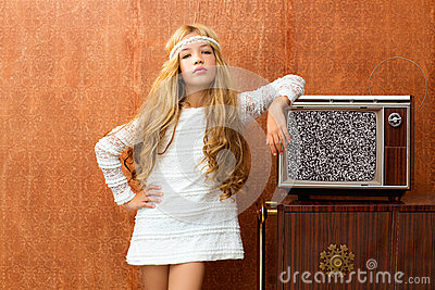 Blond vintage 70s kid girl with retro wood tv