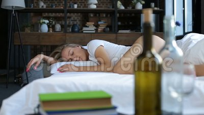 Blond wasted alcoholic woman sleeping on bed stock video footage