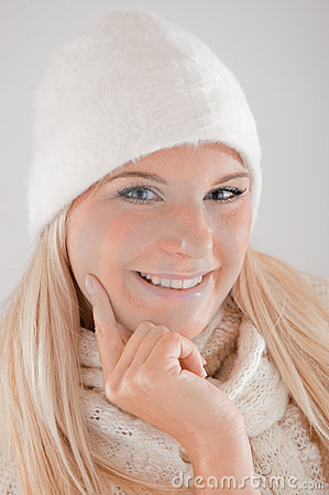 Blond winter woman with long hair and knit clothes