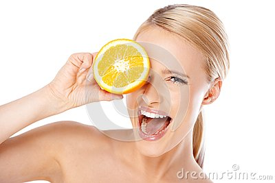 Blond woman with beautiful smile holding orange
