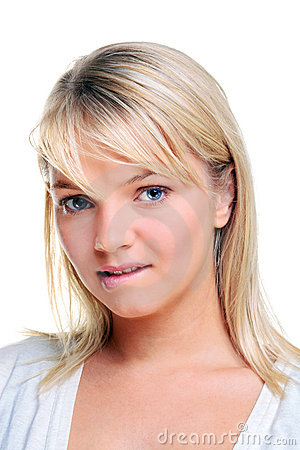 Blond woman biting her lip
