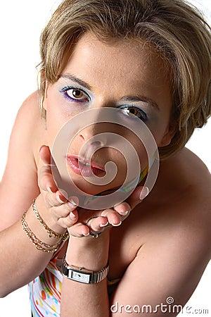 Blond woman blowing kiss