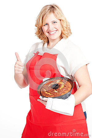 blond woman with bundt cake and red apron