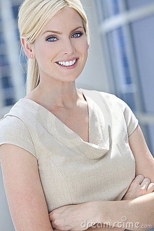 Blond Woman or Businesswoman Smiling Arms Folded