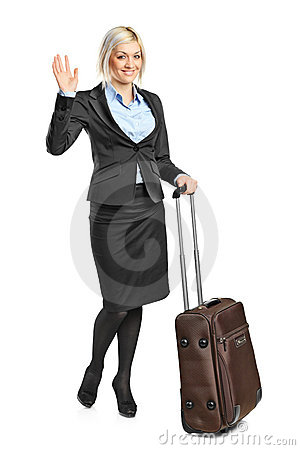 Blond woman carrying her luggage and g