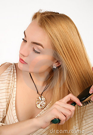 Blond woman combing