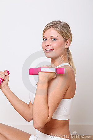 Blond woman doing fitness exercises