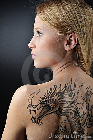 Blond woman and dragon tattoo Editorial Stock Photo
