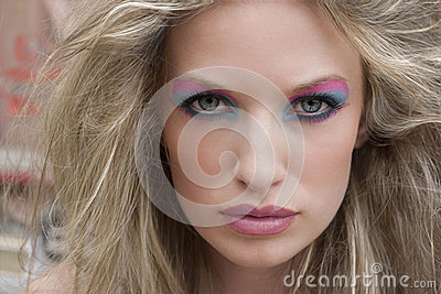 Blond woman with dramatic eyes