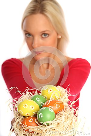 Blond woman with easter eggs