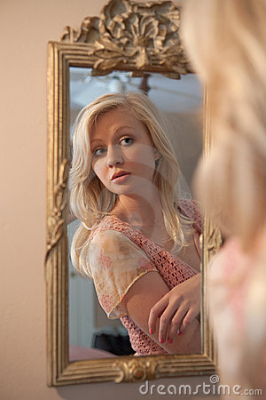 Blond Woman Gazing at Self in Mirror