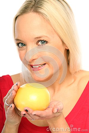 Blond woman with a grapefruit
