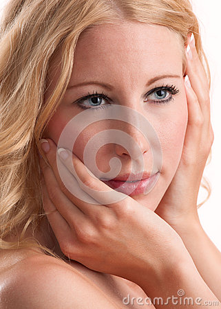 Blond woman with great hair, lips, skin and nails
