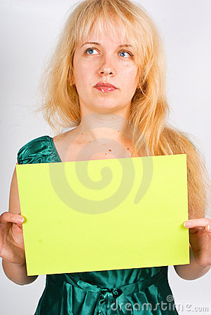 Blond woman holding a blank
