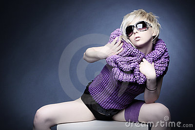 Blond woman in light violet