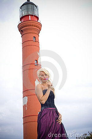 Blond woman at lighthouse