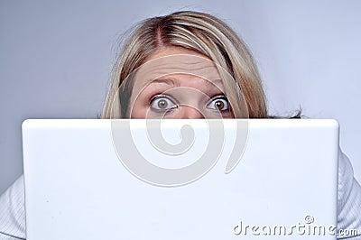 Blond Woman Looking Behind Laptop