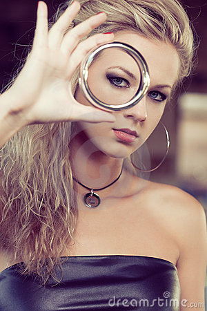 Free Blond Woman Looking Through Bracelet Royalty Free Stock Photography - 22713767