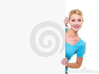 Blond woman looks out because of a banner