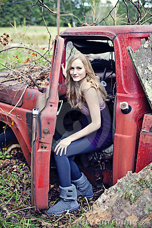 Blond woman in old truck