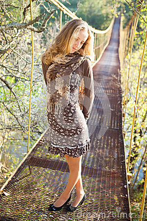 Free Blond Woman Posing On The Suspension Bridge Stock Photo - 27316280