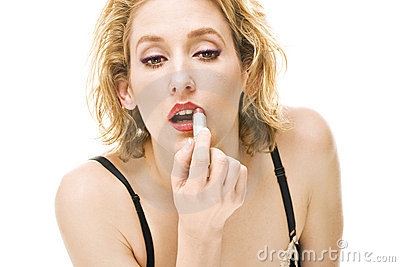 Blond woman putting red lipstick makeup