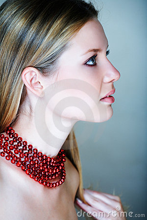 Blond Woman With Red Beads Royalty Free Stock Photos - Image: 5128438