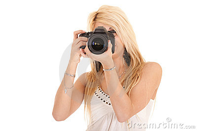 Blond woman shooting picture