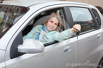 Blond woman showing ignition key