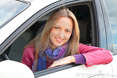Blond woman Sitting In Car