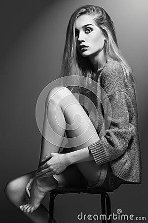 Free Blond Woman Sitting On A Stool. Beautiful Girl Royalty Free Stock Photo - 56879995