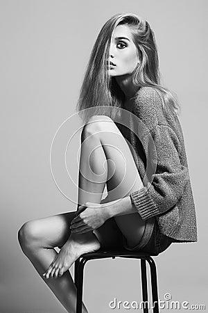 Free Blond Woman Sitting On A Stool. Beautiful Girl Stock Photo - 56880450