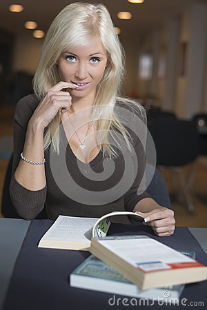 Blond woman studying