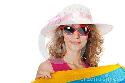 Blond woman with sunglasses at the beach